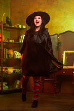 Full-length Photo Of Witch In Hat And Black Dress