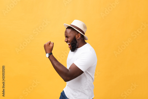 Photo  Handsome young Afro-American man employee feeling excited, gesturing actively, k