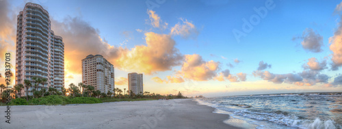 Poster Taupe Sunrise over the white sand of Vanderbilt Beach in Naples