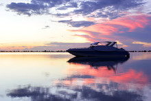 Speed Boat In The Sea With Beautiful Sunrise