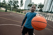 Sports equipment. Selective focus of an orange ball being used for playing basketball
