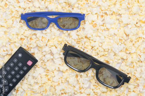 Foto op Canvas Buffet, Bar uncovered fried popcorn, close-up, as a background with a pair of 3D glasses and a TV remote control