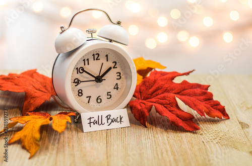 Fall Back Daylight Saving Time concept with white clock and autumn leaves, soft Tablou Canvas