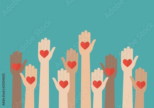 Fotografie, Obraz  Raised hands volunteering