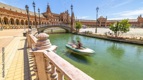 Foto op Aluminium Artistiek mon. Daily boat trip at Plaza de Espana. River with boats and moving people in Seville, Andalusia, Spain