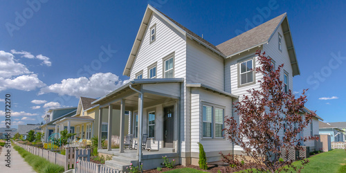 Home with porch and picket fence in Daybreak Utah Wallpaper Mural