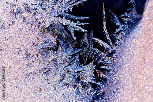 Frozen iced background. Ice pattern on the glass. Macro frost