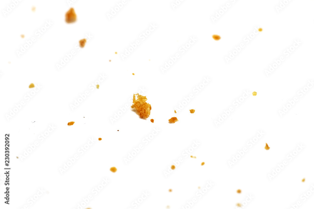 White bread crumbs on a white background close up