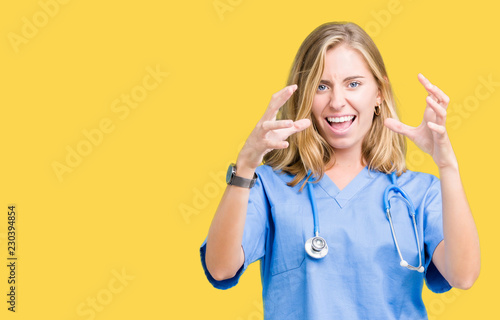 Fotografie, Obraz  Beautiful young doctor woman wearing medical uniform over isolated background Sh