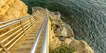 Sunlit Stairs On A Cliff Going...