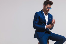 Elegant Man In Sunglasses Is Sitting And Touching His Hands