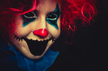 Creepy Clown Close Up Halloween Portrait On Black Background