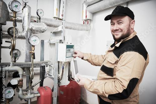 Stampa su Tela heating engineer or plumber inspector in boiler room taking readouts or adjustin