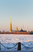 Saint Petersburg. View On The Peter And Paul Fortress And The Frozen Neva River With Ice Hummocks In A Cold Winter Afternoon