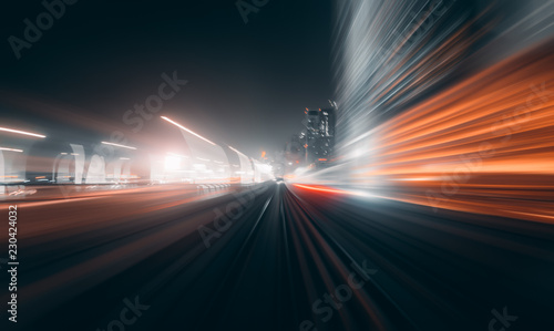 fototapeta na ścianę View from first railway carriage. Speed motion blur metro abstract background at night