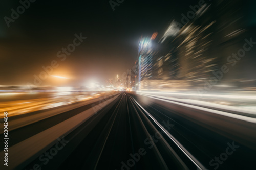 obraz dibond View from first railway carriage. Speed motion blur metro abstract background at night