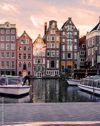Photo  Amsterdam during Autumn by the canals with boats and house, historical center of