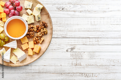 Cheese plate - various types of cheeses with honey
