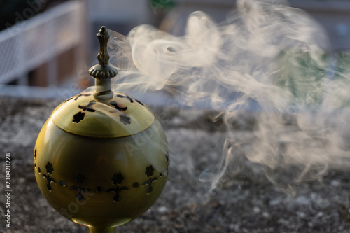 Fotografia, Obraz  incense burner censer with smoke and blurred background.