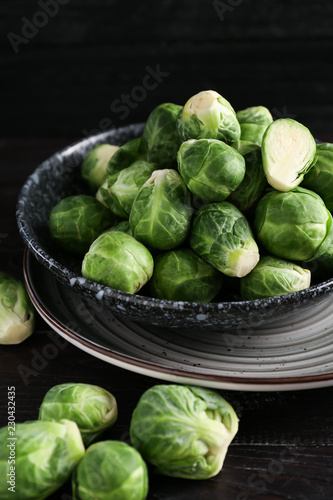 Plate with fresh brussels sprouts on table, closeup
