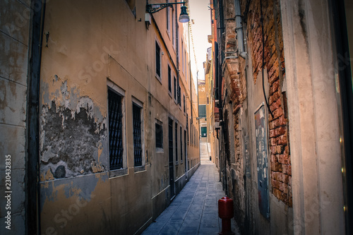 Beautiful narrow street in Venice Italy