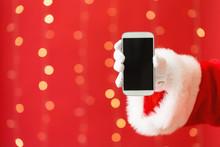 Santa Holding A Smartphone On ...