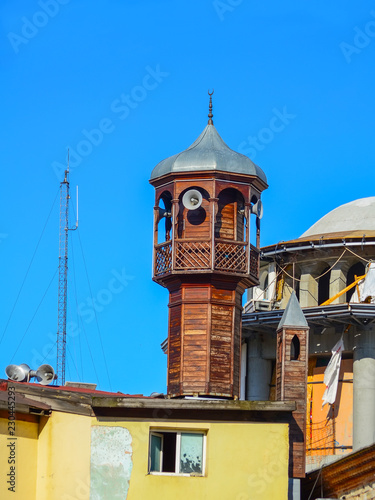 Valokuva  Wooden Minaret of a small mosque against the blue sky in Istanbul
