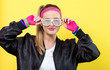 Woman in 1980's fashion with shatter shade glasses on a yellow background