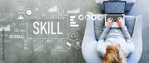 Skill with man using a laptop in a modern gray chair Wallpaper Mural