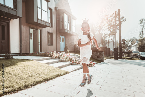 bb0138f294d Beautiful dark-haired schoolgirl feeling extremely happy having a walk near