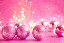 Pink Christmas Balls Background. New Year Balls On Abstract Shiny Pink Background. Copy Space. Soft Selective Focus