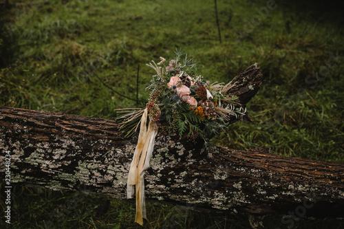 Obraz na plátně harvest bouquet of fall flowers on a log