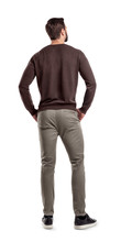 A Back View On A Modern Fit And Casually Clothed Man That Stands In A Relaxed Posture And Looks Sideways.