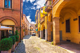 Fototapeta Uliczki - Picturesque buildings on one of the narrow medieval streets in Padua, Italy.