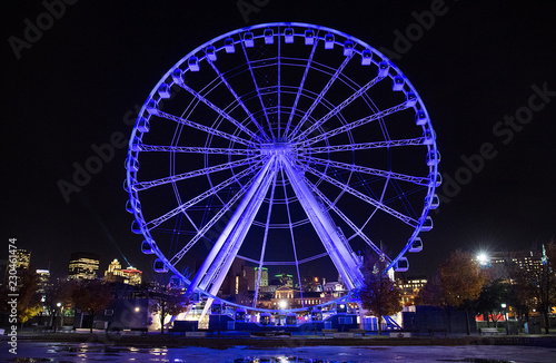 Deurstickers Antwerpen A ferris wheel is shown in the Old Port of Montreal