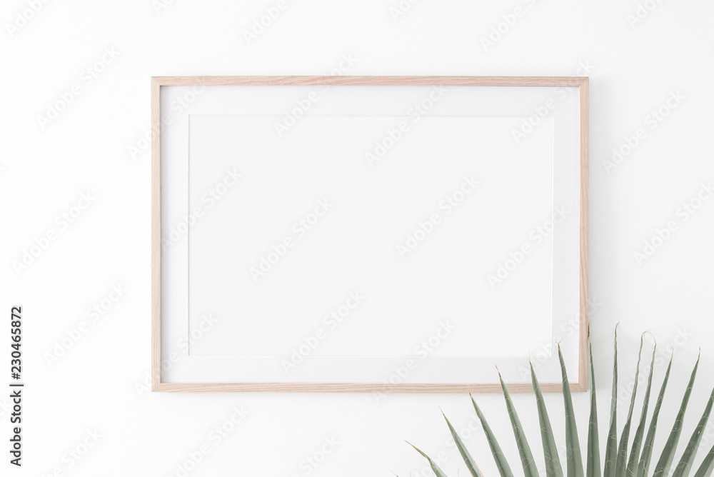 Fototapety, obrazy: Landscape large 50x70, 20x28, a3,a4, Wooden frame mockup with passe-partout on white wall and palm leaf. Poster mockup. Clean, modern, minimal frame. Empty fra.me Indoor interior, show text or product