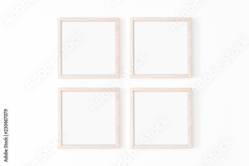 Fototapeta Set of four square frmes. Wooden frame mockup on white wall. Poster mockup. Clean, modern, minimal frame. Empty fra.me Indoor interior, show text or product obraz
