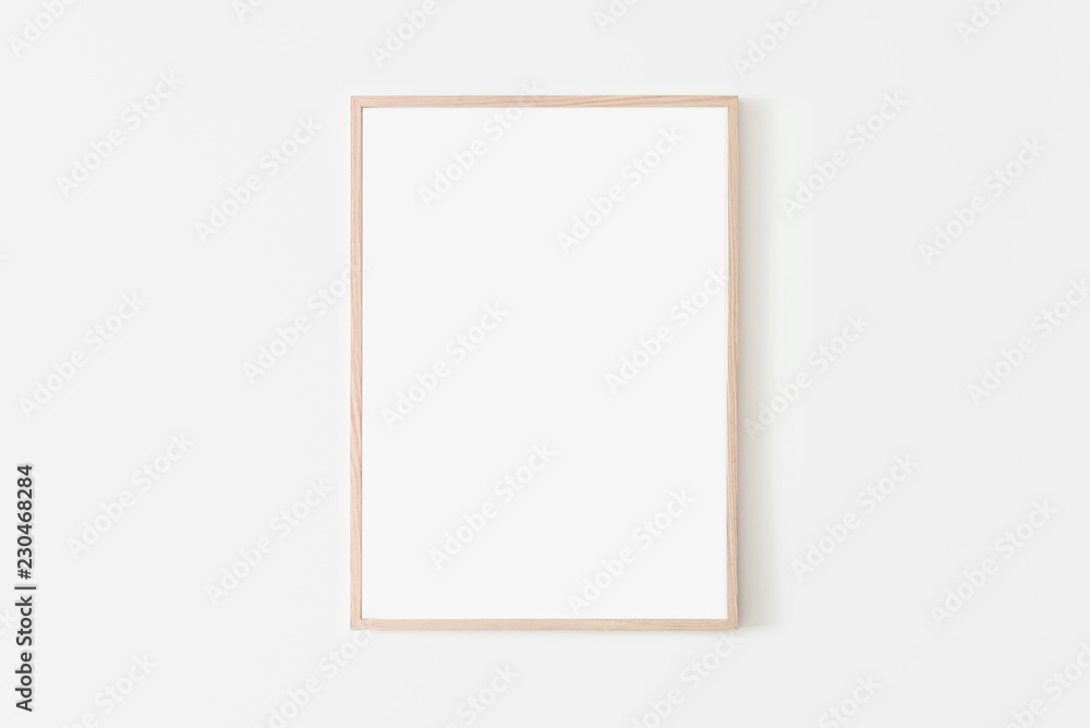 Fototapety, obrazy: Portrait large 50x70, 20x28, a3,a4, Wooden frame mockup on white wall. Poster mockup. Clean, modern, minimal frame. Empty fra.me Indoor interior, show text or product