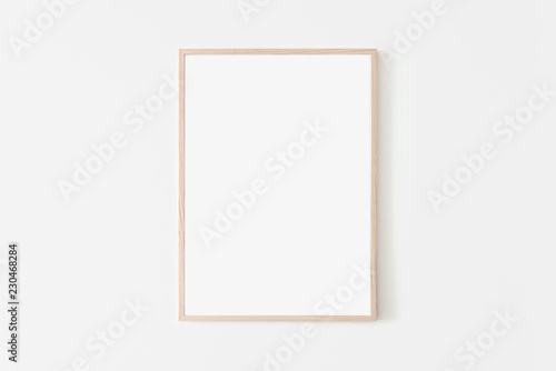 Fototapeta Portrait large 50x70, 20x28, a3,a4, Wooden frame mockup on white wall. Poster mockup. Clean, modern, minimal frame. Empty fra.me Indoor interior, show text or product obraz