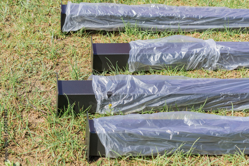 Fotografia, Obraz  new metal piles in plastic package on construction site