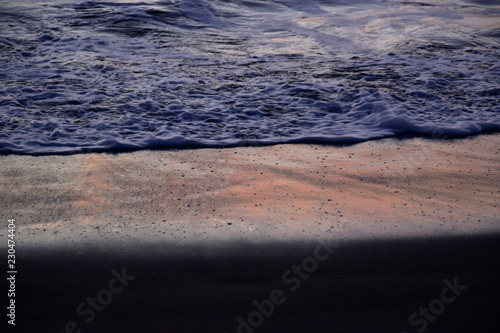 Waves on the shore of the beach