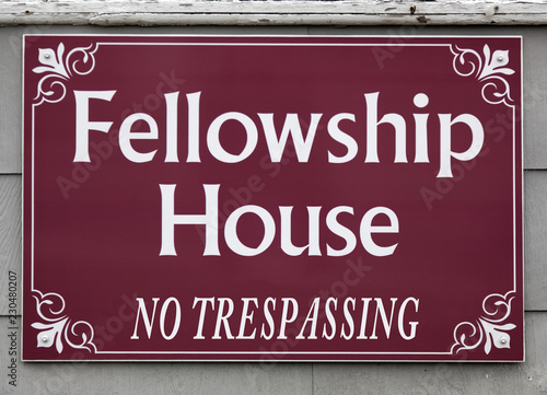 Fotografie, Tablou  Fellowship House sign with humorous ironic tag mounted on wall.