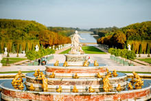 Versailles Gardens With Latona Fountain And Grand Canal During The Morning Light In Versailles, France