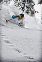 Skier Skiing Down A Hill