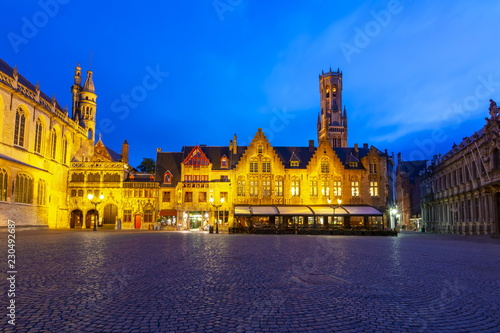 Burg square with Basilica of the Holy Blood and Belfort tower at background at night, Bruges, Belgium