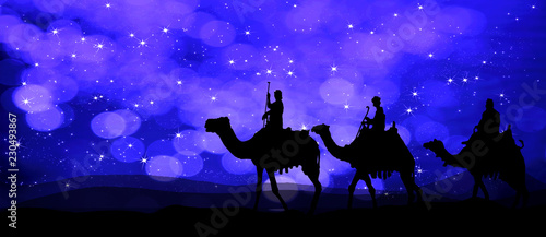 Fotografía Three kings - wandering in the desert at night on the background of the sky glis