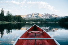 An Empty Boat On The Way With Mountains And Trees In The Background