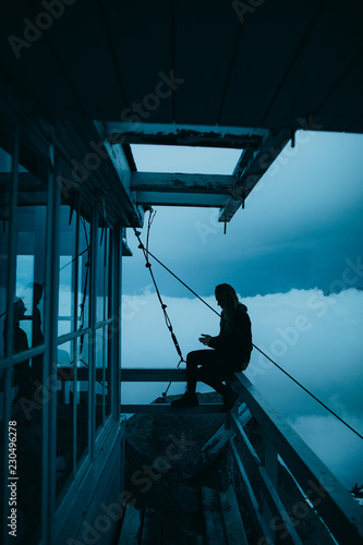 Person sitting outside on a ledge