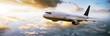 canvas print picture - Flugzeug fliegt in den Sonnenuntergang