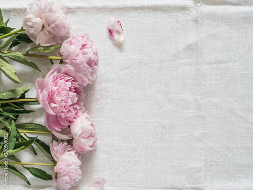 peony bouquet on white tablecloth